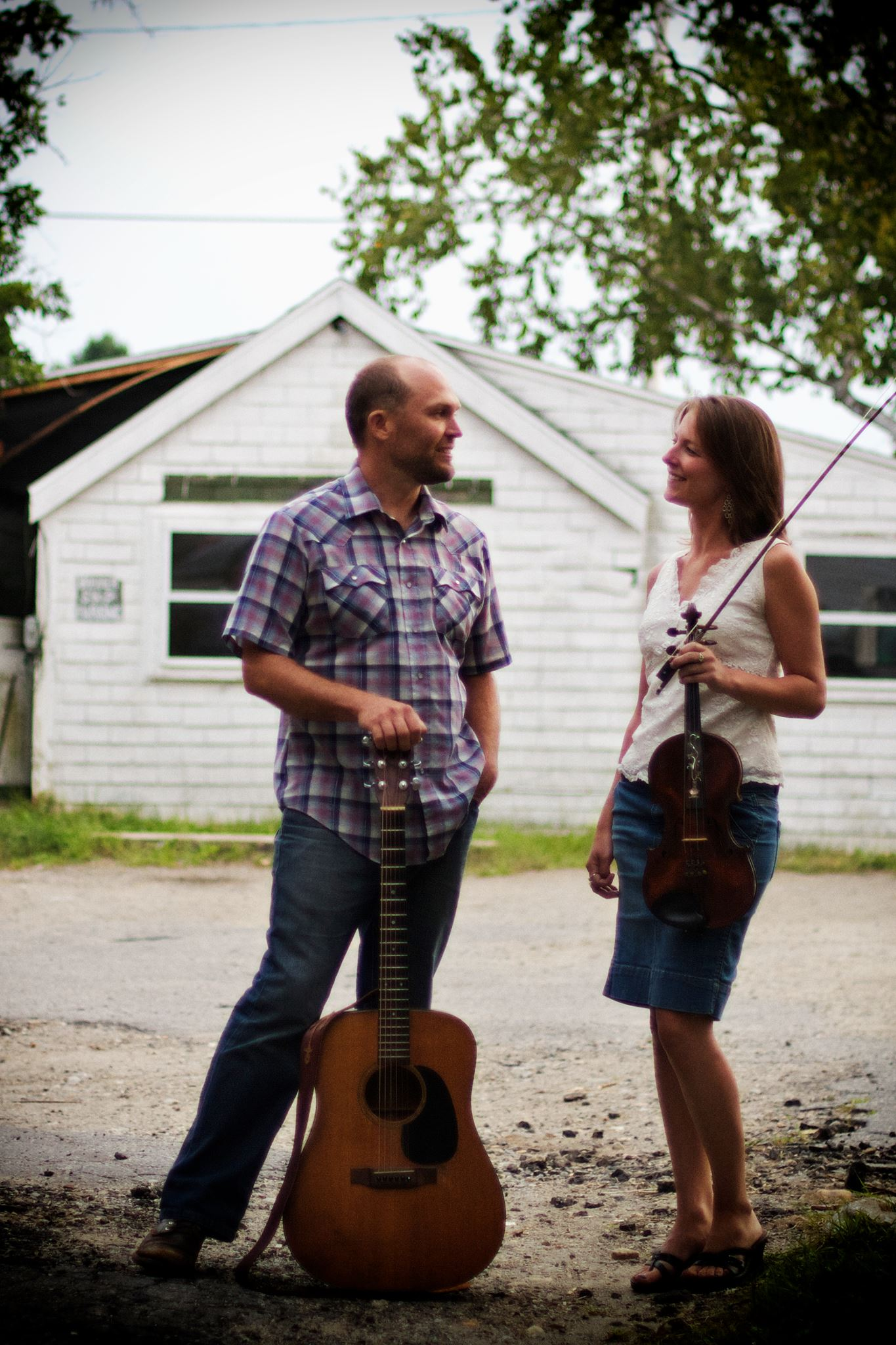 About  A delightful blend of vocal harmonies accompanied by fiddle, banjo, mandolin and guitars, a unique version of bluegrass, old time, folk and original songs.