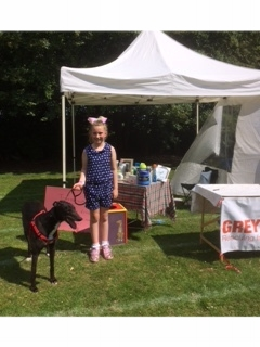 Madalaleine helping out on the stall at her school fair