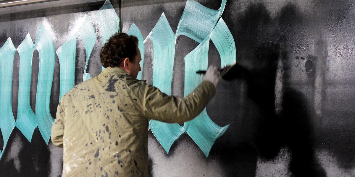 Niels-Shoe-Meulman-working-on-Unrulyrics-project-in-Amsterdam-image-courtesy-of-Calligraffiti.jpg