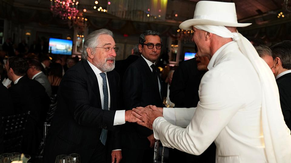 Robert De Niro of Nobu Hospitality and Alan Faena of new Five-Star Faena Hotel Miami Beach say hello at the Forbes Travel Guide gala.    Photo Credit: Camp Art Productions and Don Camp