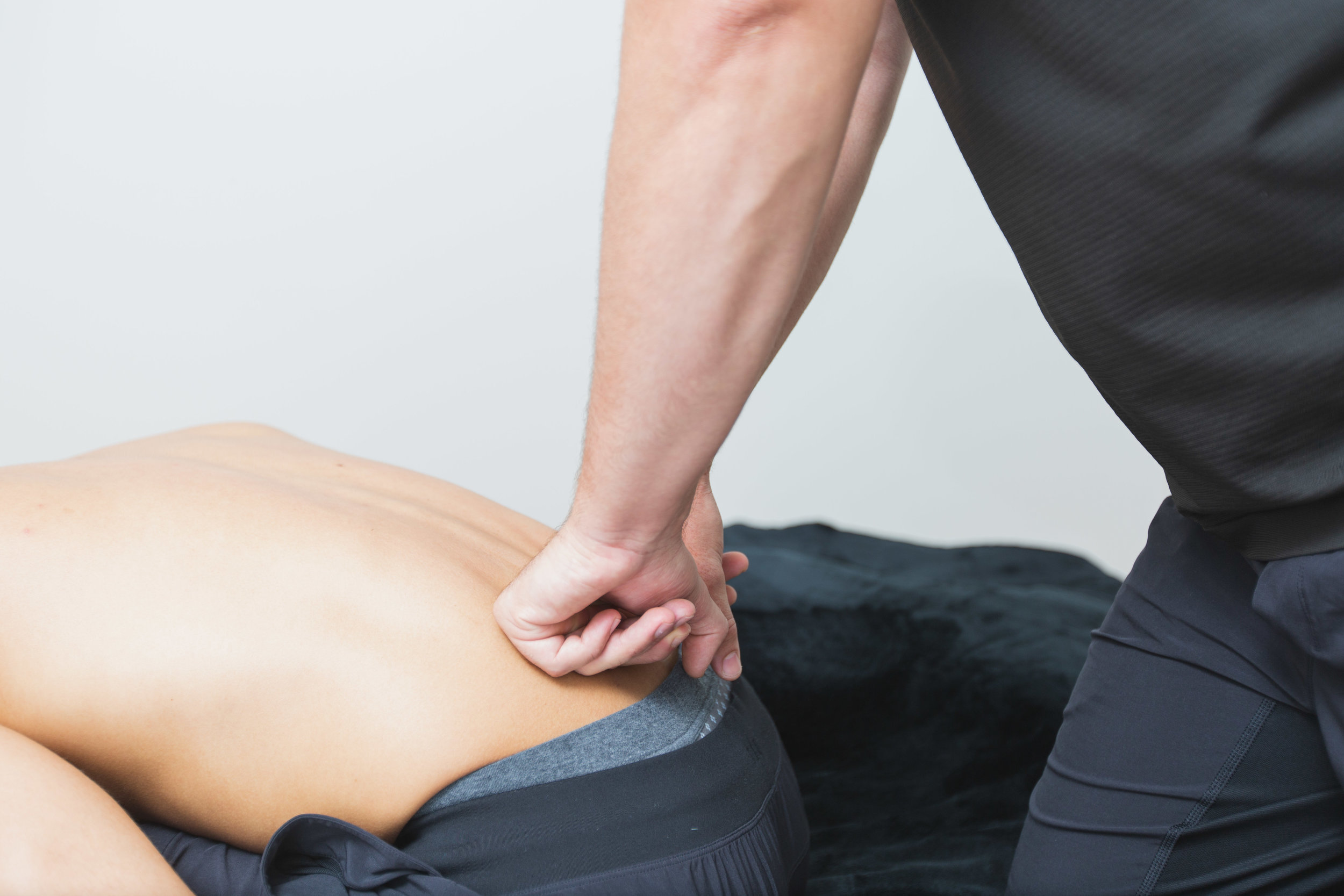 """One of my favourite methods of releasing this structure is """"back stripes."""" To perform this technique, get the patient sitting on the edge of a table. Using either your elbows or knuckles, slowly but firmly run them down either side of their spine, from their upper to lower back"""