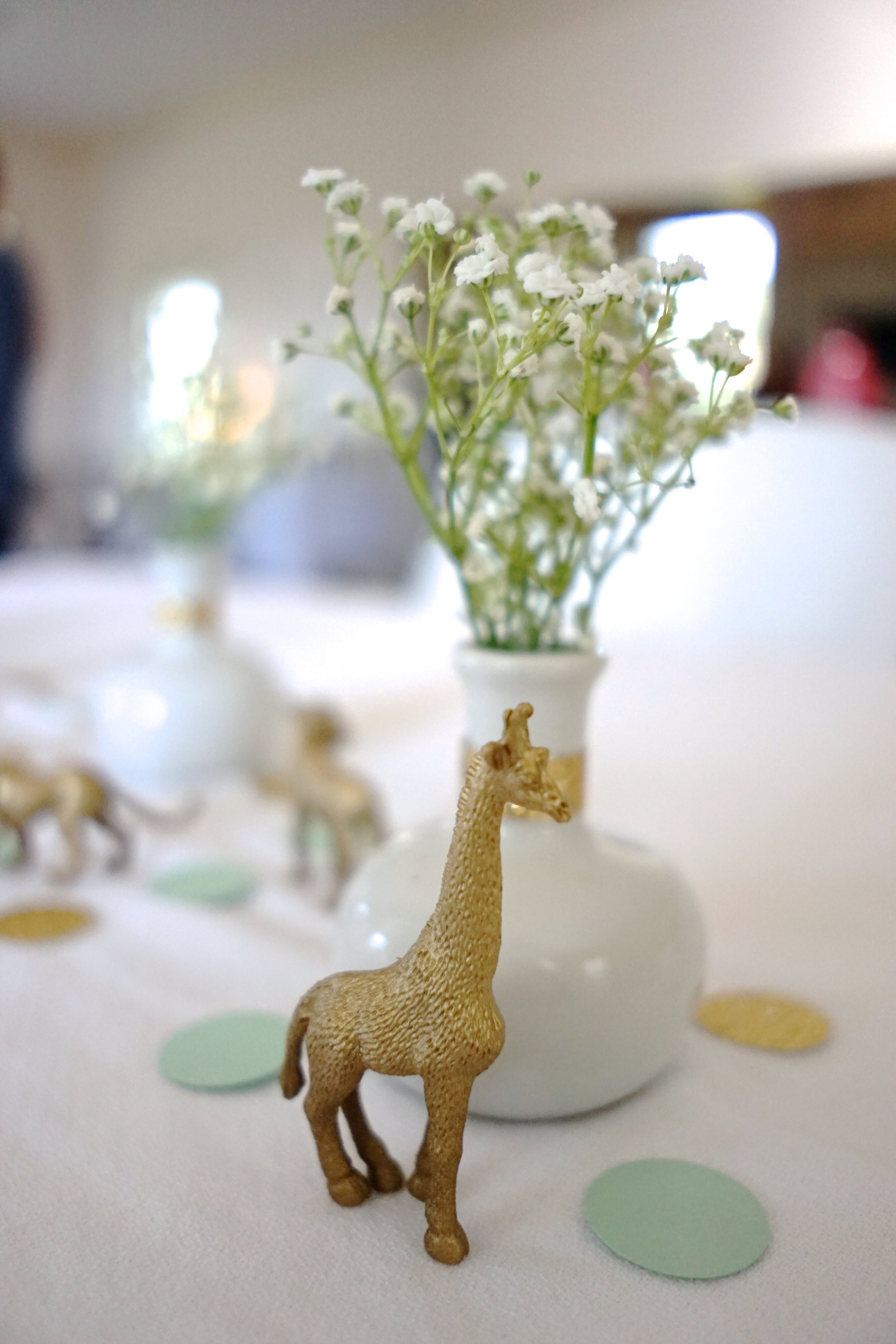 Mint + Gold Safari Baby Shower Brunch    This simple and elegant baby shower brunch for mom-to-be Katherine features gold-painted safari animals and a sophisticated color palette of mint, gold and white. Be sure to check out the children's book gift station and the boxed animal cracker favors.