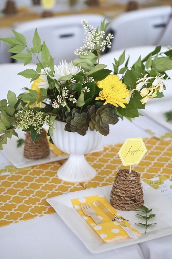 Honey Bee Joint Baby Shower    This perfectly sweet Honey Bee-themed celebration was a joint baby shower for two expectant mamas! Bee on the lookout for handmade rope bee skep place card holders, loads of honey gold hexagons, and sweet yet simple floral arrangements.