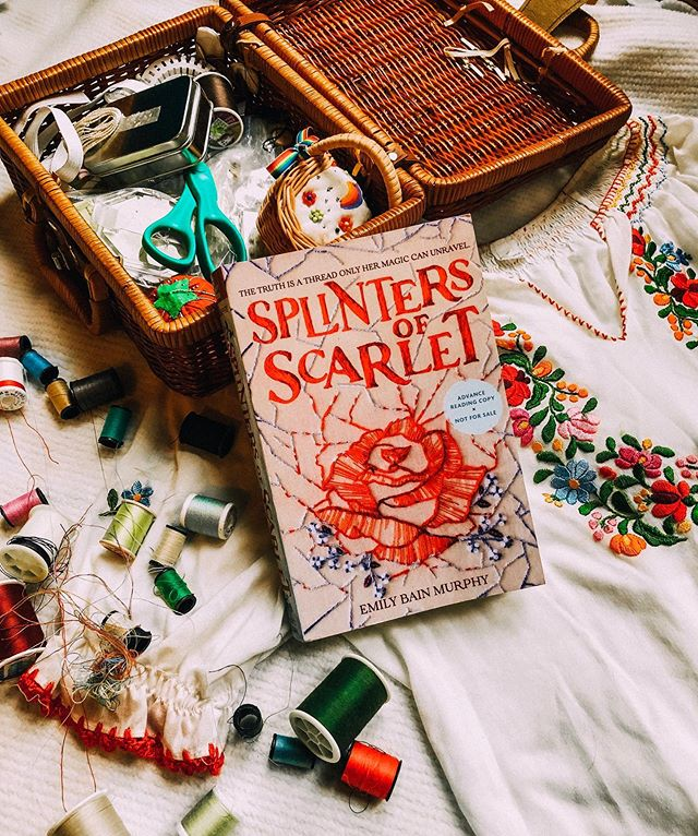 SPLINTERS OF SCARLET by @emilybainmurphy is my new favorite YA historical fantasy! 😍 It has everything I wanted and didn't know I needed, all woven into a beautifully immersive book. Five stars for this read! ⭐️⭐️⭐️⭐️⭐️ Go ahead and put #SplintersOfScarlet on your summer 2020 #TBR list. 💁🏼♀️ I'd describe it as Downton Abbey meets Frozen with the opulence of Anna Karenina. Ah, I really can't express how much I enjoyed the actual writing! So vivid and detailed. (*cue applause*) Thanks for the ARC, Emily! I hope I captured Marit's magic in this photo. ———————————————————- QUESTION: If you could be excellent at any one skill, which skill would you choose? 🧵 ✨ ———————————————————- @taylor.bennett.author tagged me in her #WriterlyIntros movement. What do you write the most of? 🖊 Romantic YA, all subgenres. What is something you've always wanted to write but never have? 💕 I've always wanted to write the script for a Nancy Drew computer game. Screenplays are also on my to-write list! What is your favorite writing snack? ☕️ COFFEE! It's a food group. What never fails to inspire you? 🌎 Music and travel. Beautiful scenery wrecks me. What's better—writing or editing? 📝Writing. Do you let people read your work while you're in the middle of a draft? 💁🏼♀️ Yes! I have a small group of beta readers who help me finetune voice, pacing, etc. What is your goal for your writing? ☑️ To tell stories that inspire, entertain, and speak truth. To use my platform to encourage others. 😊 I tag @katiepcreative, @stephiekehr, and @djharringtonwriter * * * * * #lifestyleblogger #aesthetic #lifestylephotography #photography #writing #author #blogger #instagood #authorsofinstagram  #amwriting #bookstagram #reader #bookblogger #writersofinstagram #booknerd #reading #lifestyle #digitalnomad #creativelifehappylife #amreading #writer #thatsdarling #bookhaul #bookworm #writingcommunity #itsfallyall