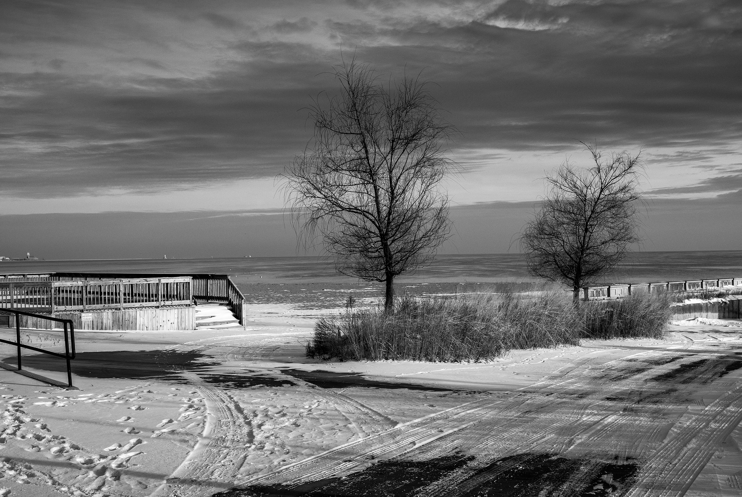 Evidence of Humans on the Winter Morning on the Lake