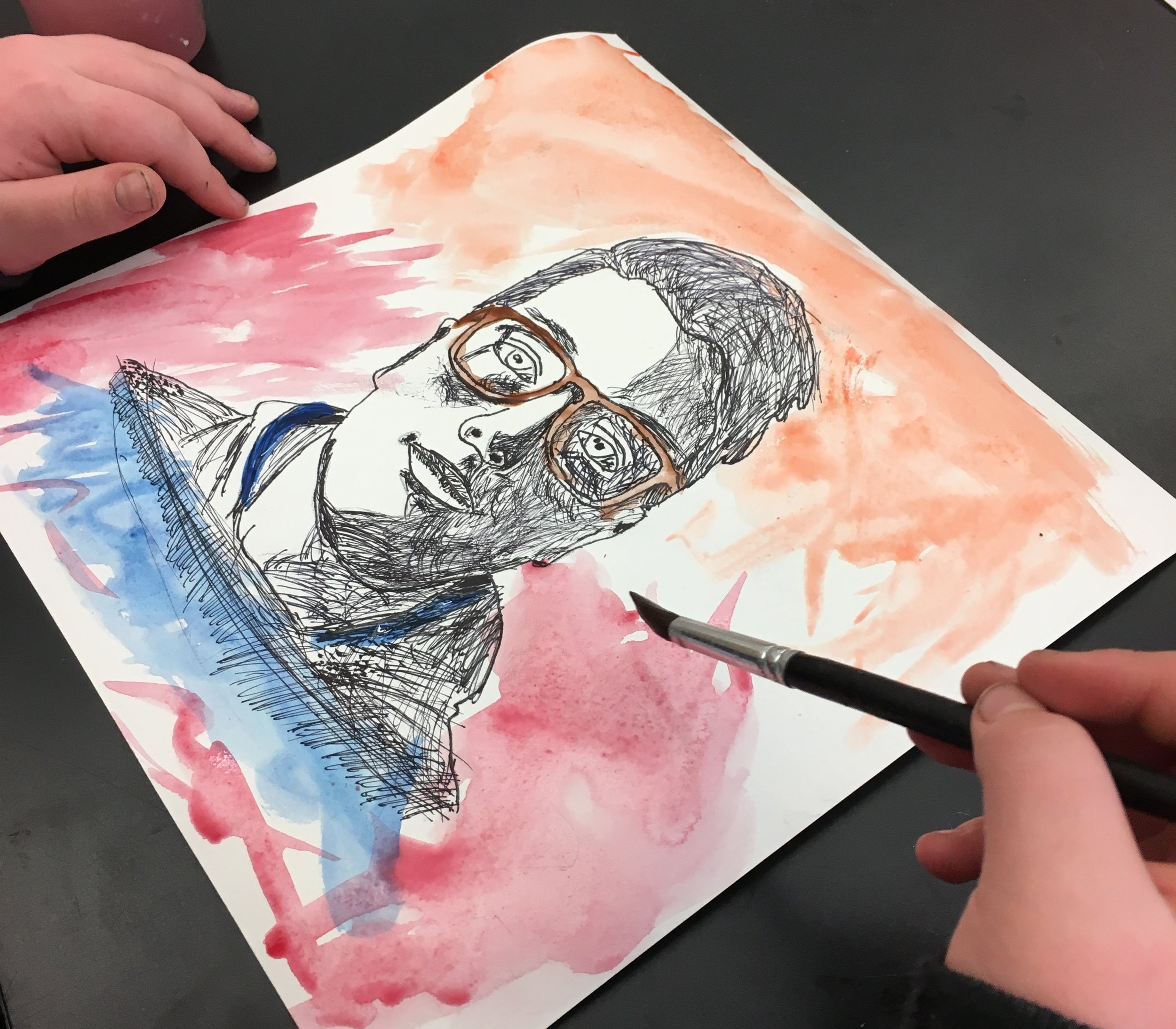Self Portraits - 6th Grade Students created self portraits using value with line and expressive watercolor techniques. Students began by tracing the outline of a black and white photos of themselves and then added value using line variation. Students were encouraged to not use pencil for the line making and take the risk with sharpie. Students then used a variety of watercolor techniques to bring the portrait to life.