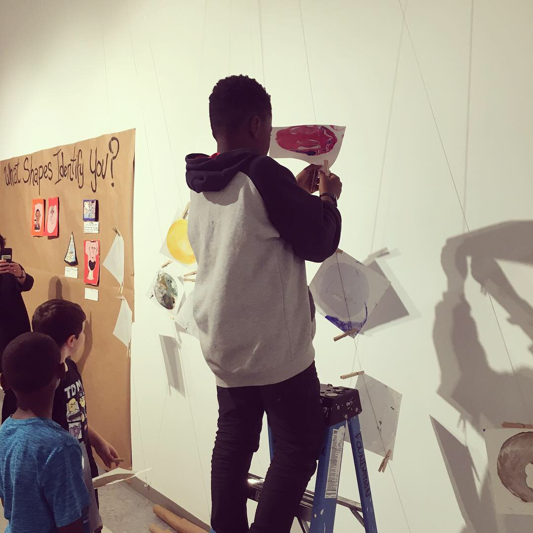 Students took a field trip to a MECA (Maine College of Art) Gallery to install their work.