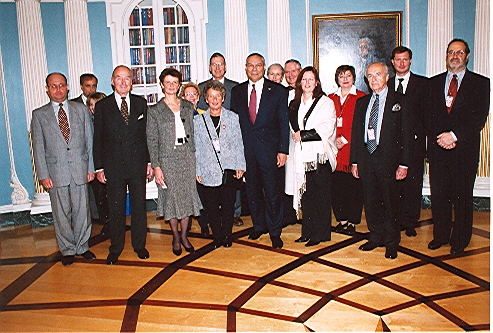 Reception for the families of the Visas for Life diplomats with Secretary of State Colin Powell at the State Department, Washington, DC, 2003.  Eric Saul (right).