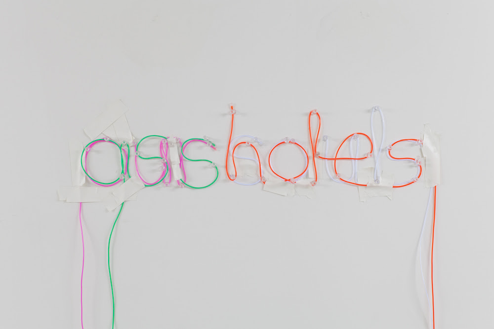 OUR SOULS ASSHOLES,  2013,   EL wire, tacks and tape, 6 x 12 x 1 inches