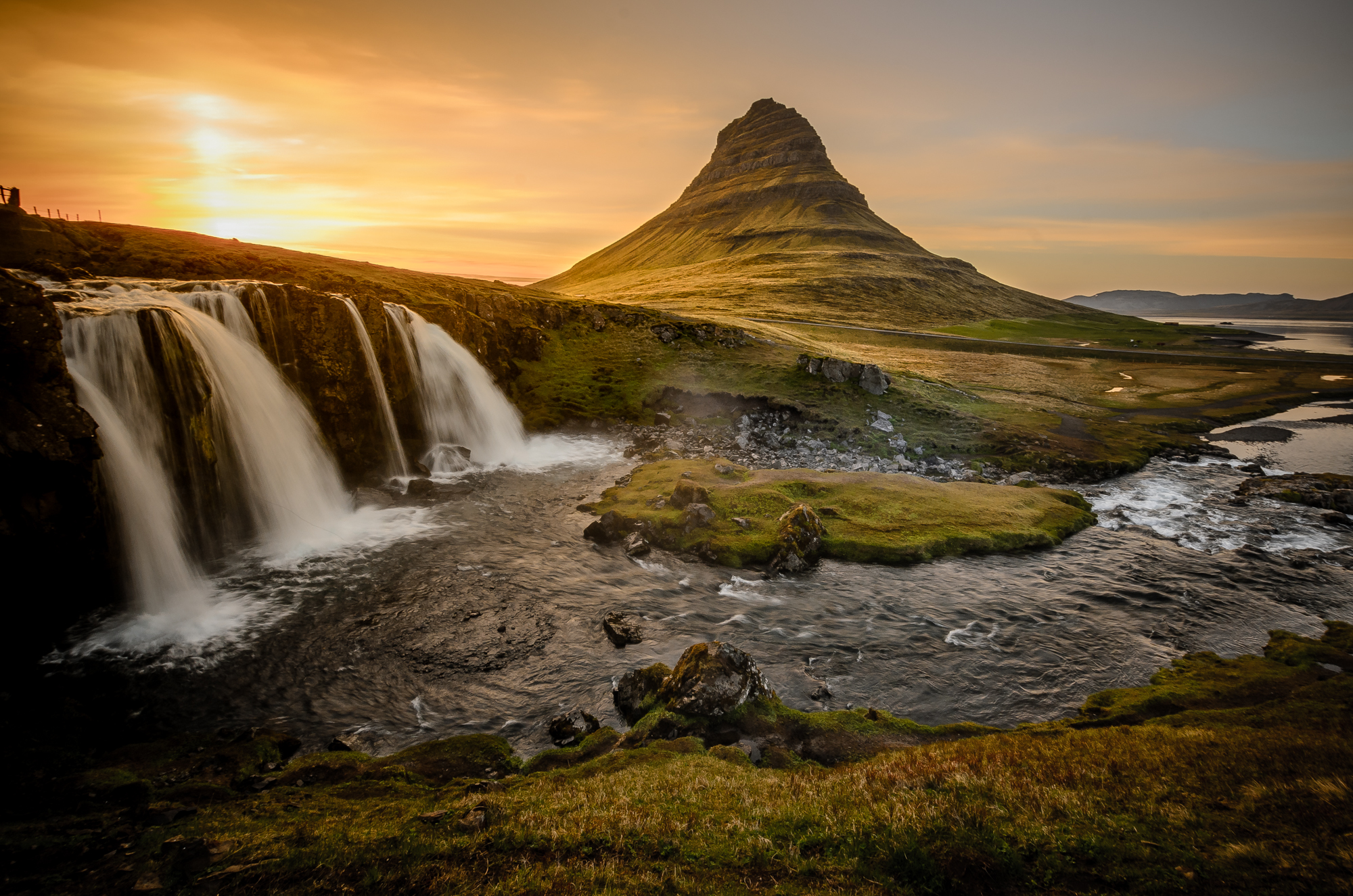 The very well known Kirkjufellsfoss waterfall just outside the town of Grundarfjörður.
