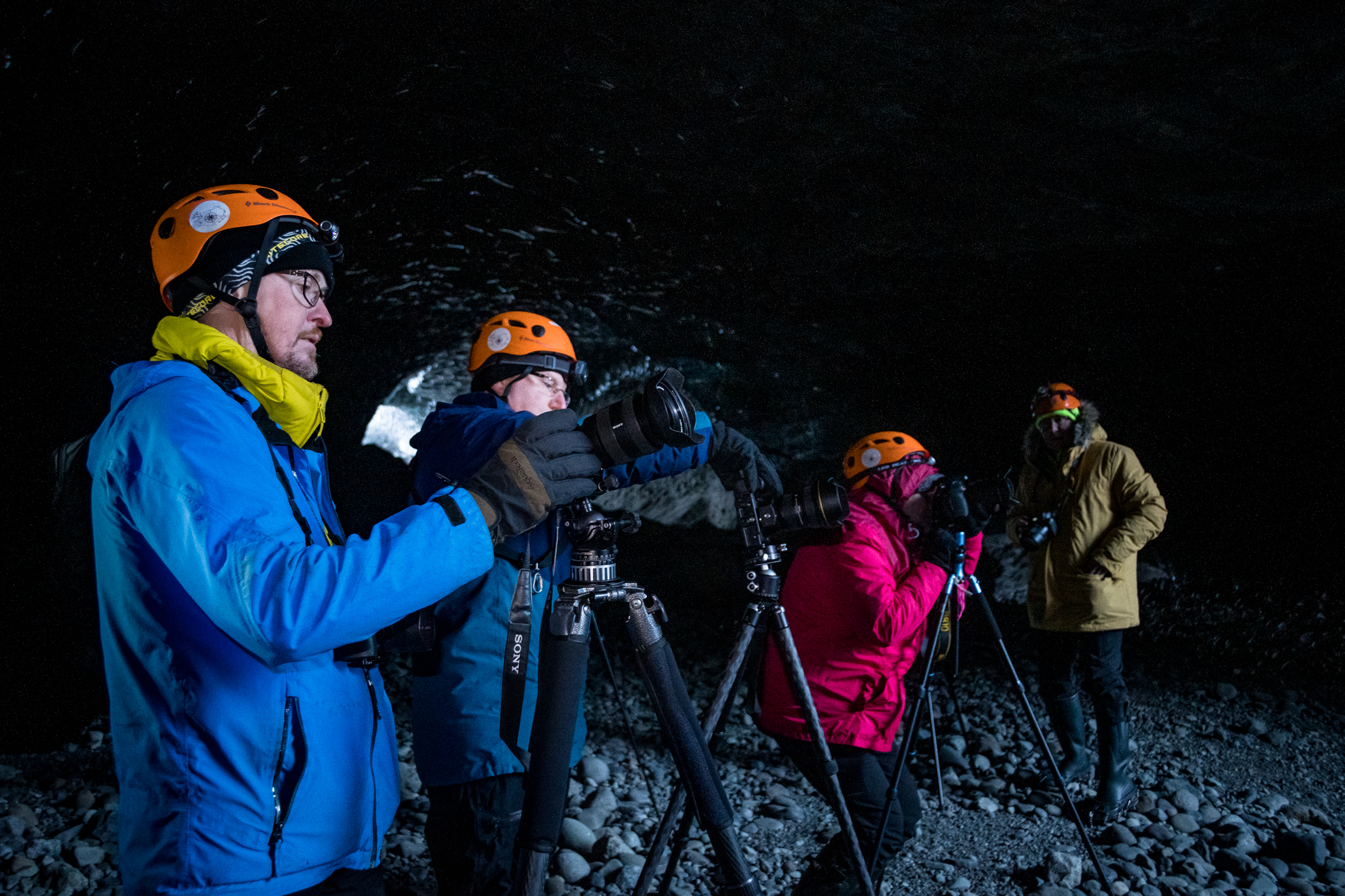 Páll Jökull shooting inside the cave together with the workshop participants.