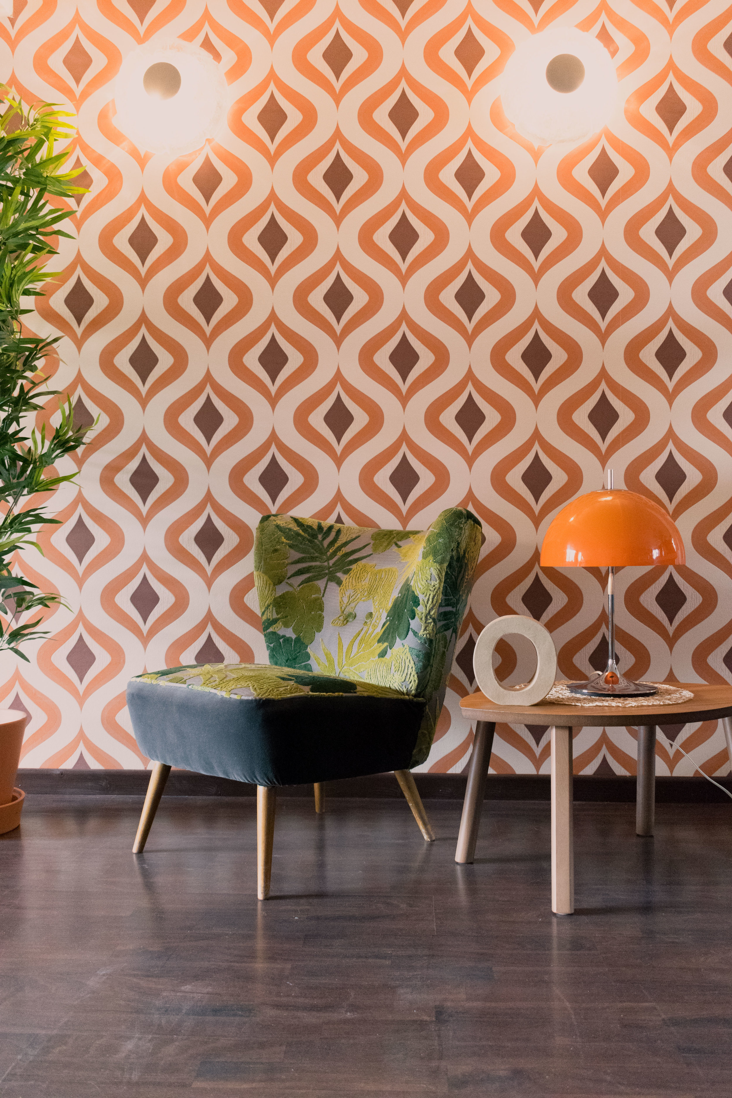 Avocado green chair and 1970's wallpaper