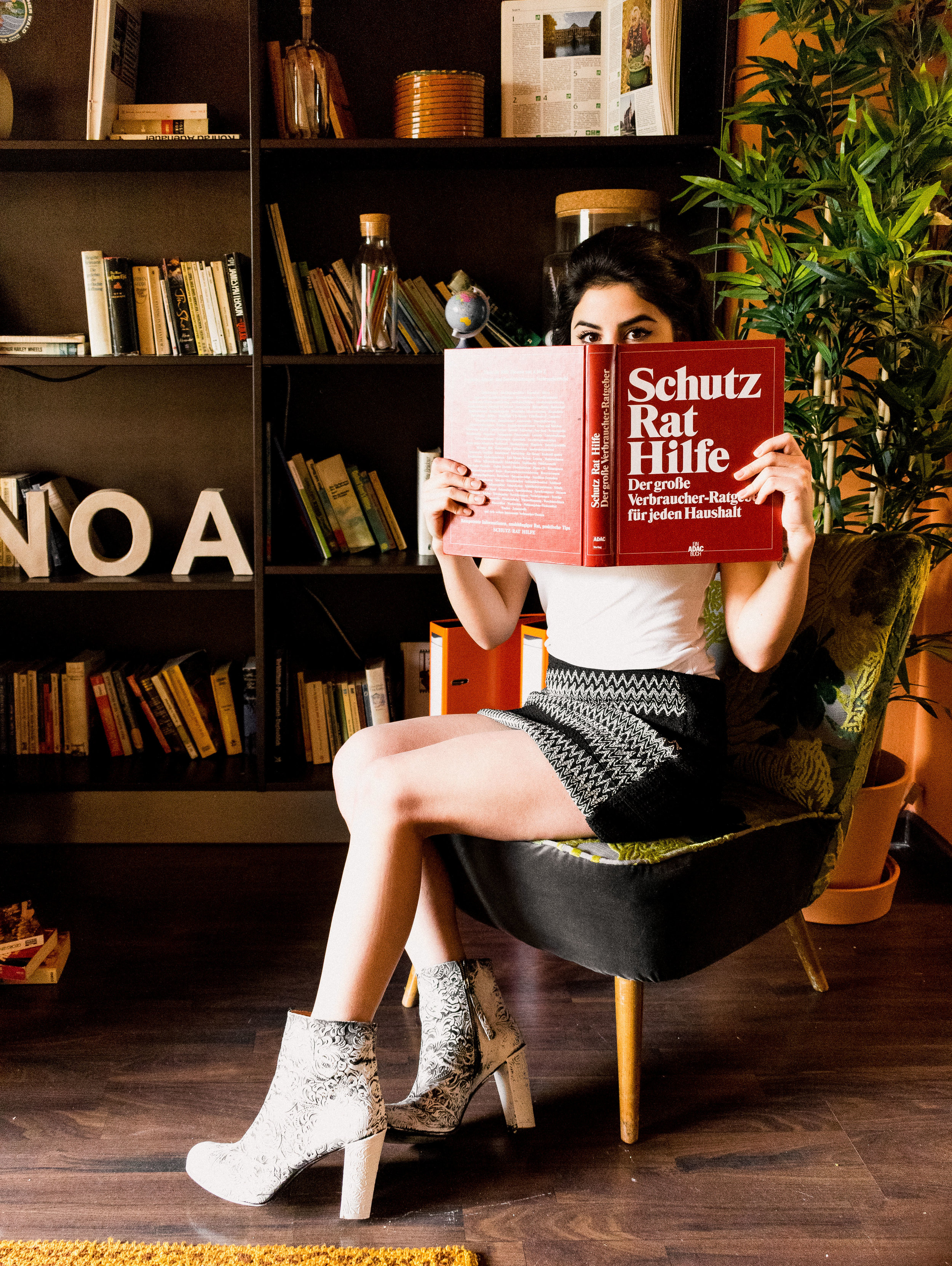 Model Estefania Diaz reading whilst on our Jungle Print chair