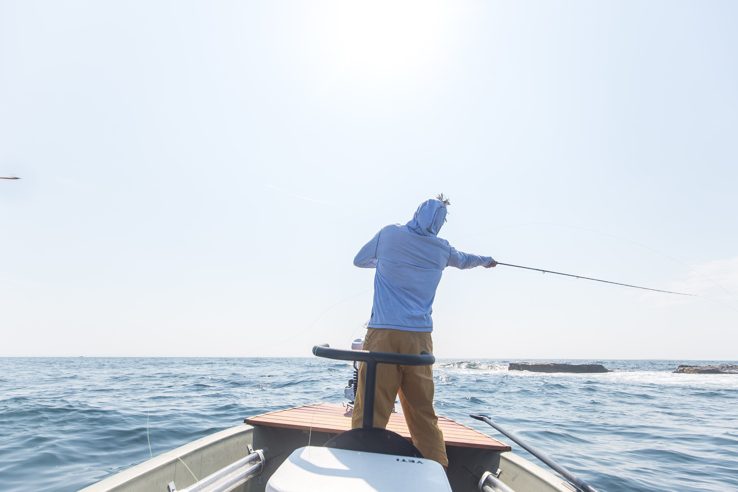 Fishing the rocky coast of Maine, searching for stripers holding in the complex current created by rolling waves and moving tides. Photo: Ben Carmichael