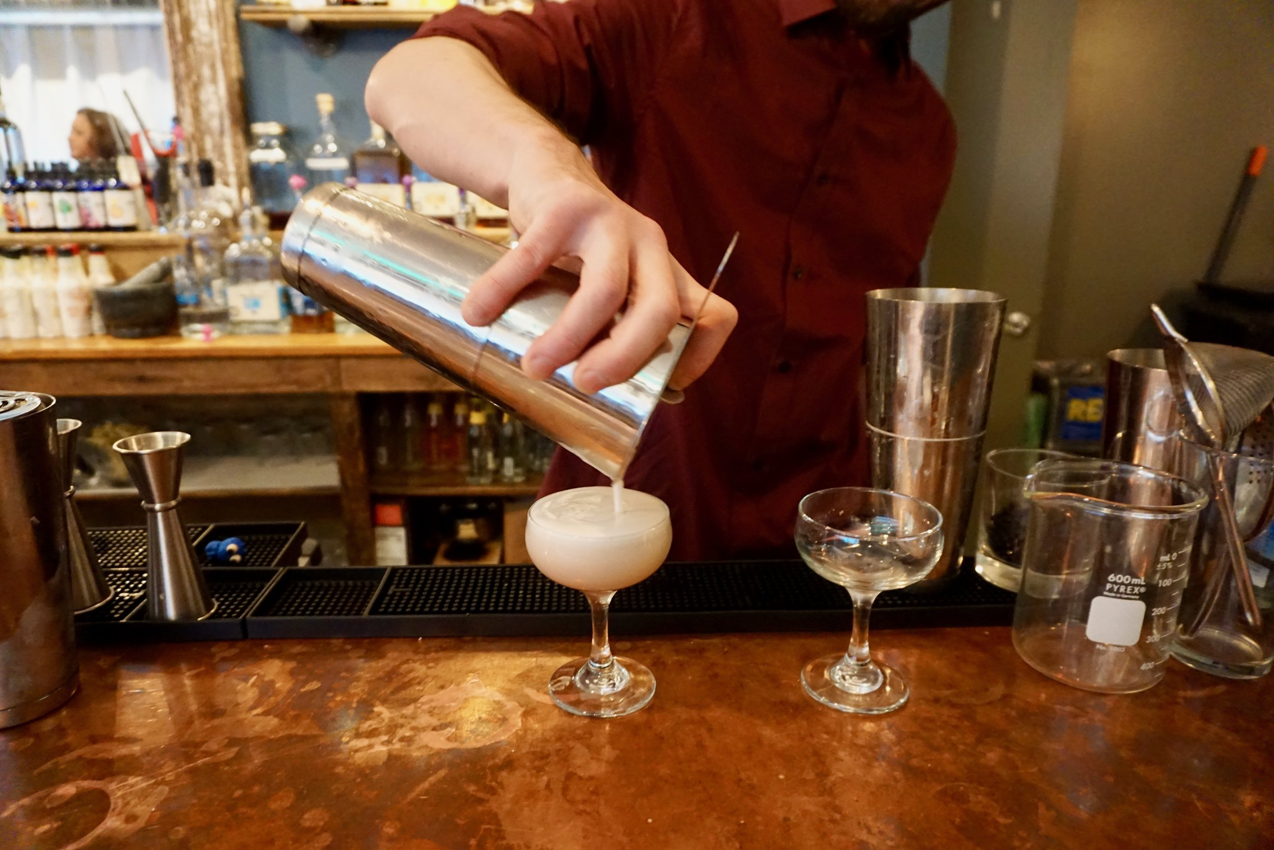 Bar manager Mike Cohen pouring out his take on The Clover Club