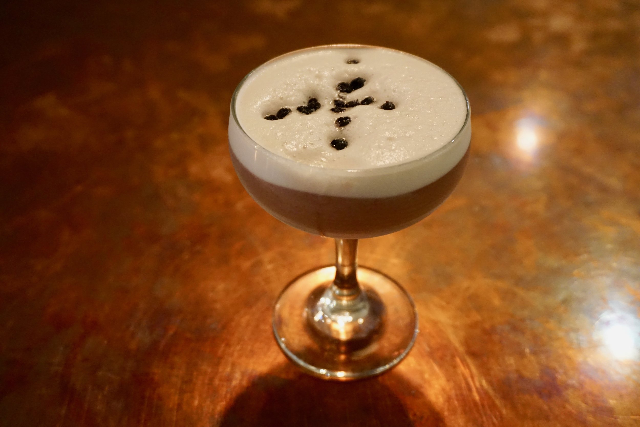 """Cohen's """"OG classic-meets-new Philly"""" Clover Club made from Keystone whiskey, Chester County-sourced honey and dehydrated blueberries"""
