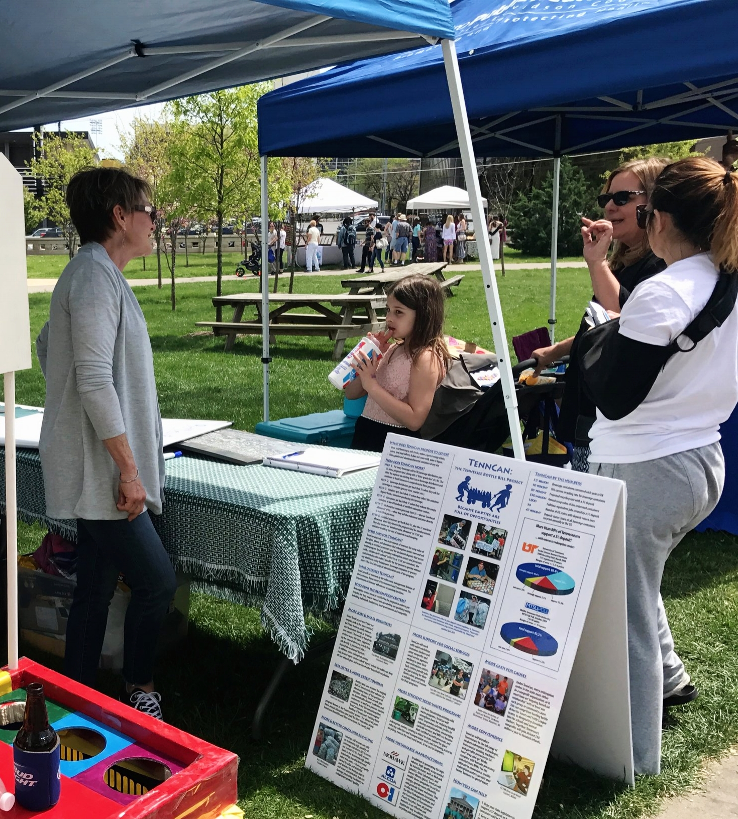 Susan Appelt explains TennCan to interested festival-goers.