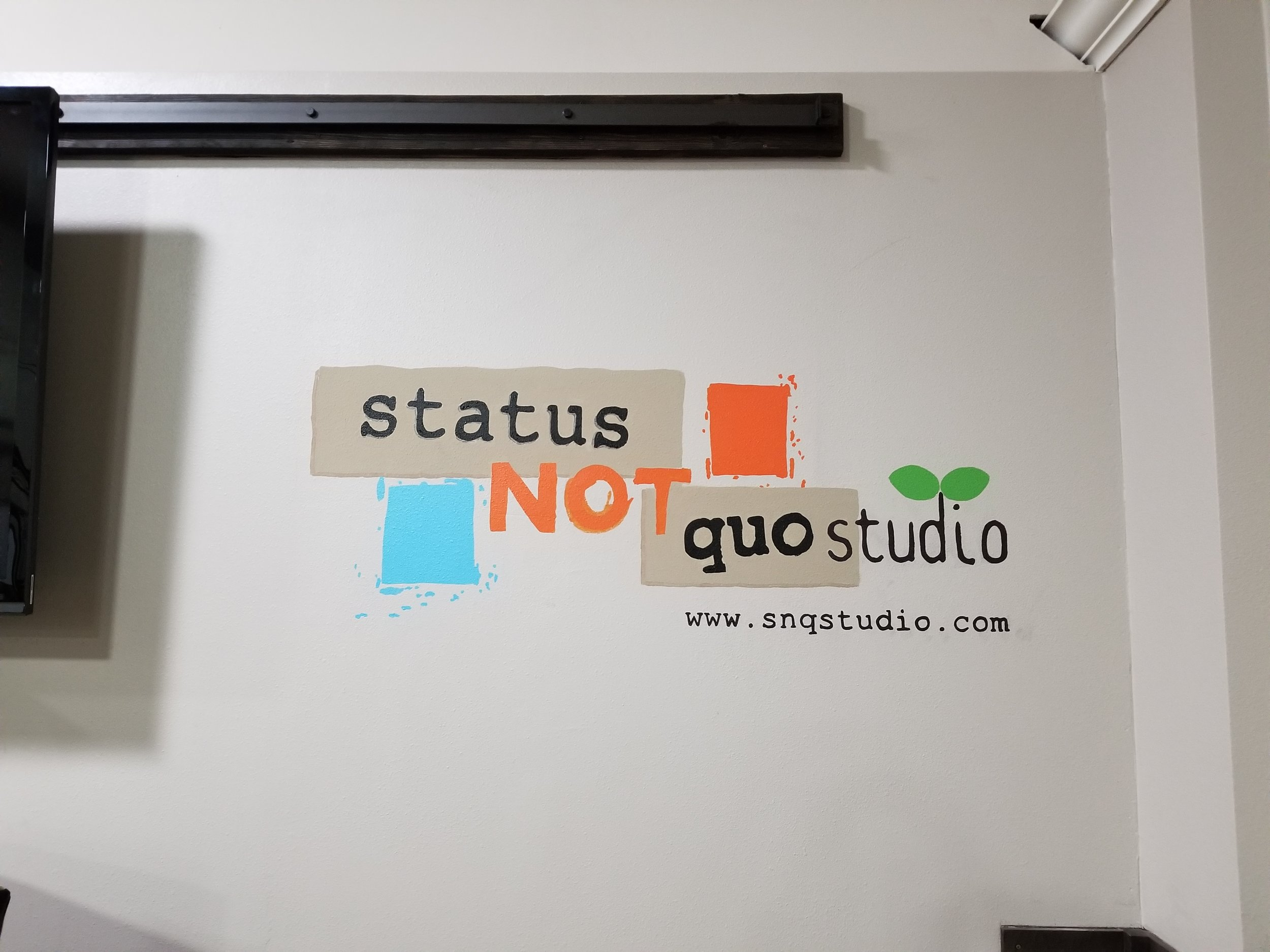 SNQ Studio logo