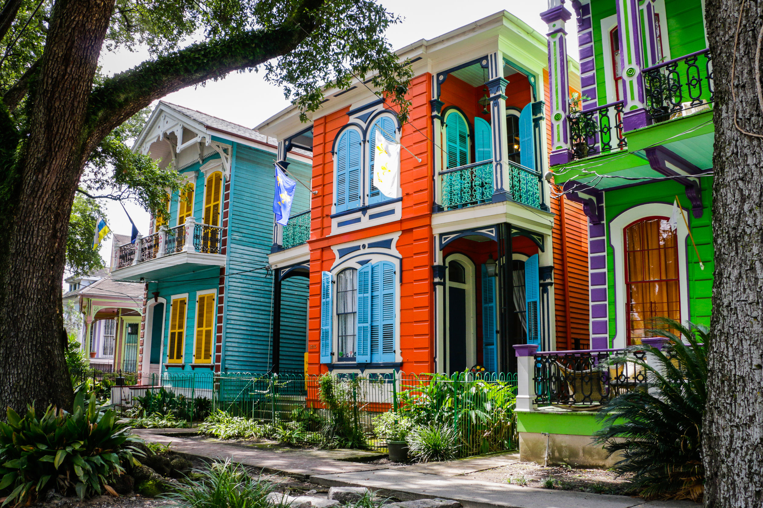 Beautiful houses and beautiful people are all along the sidewalks on Esplanade Avenue in New Orleans.