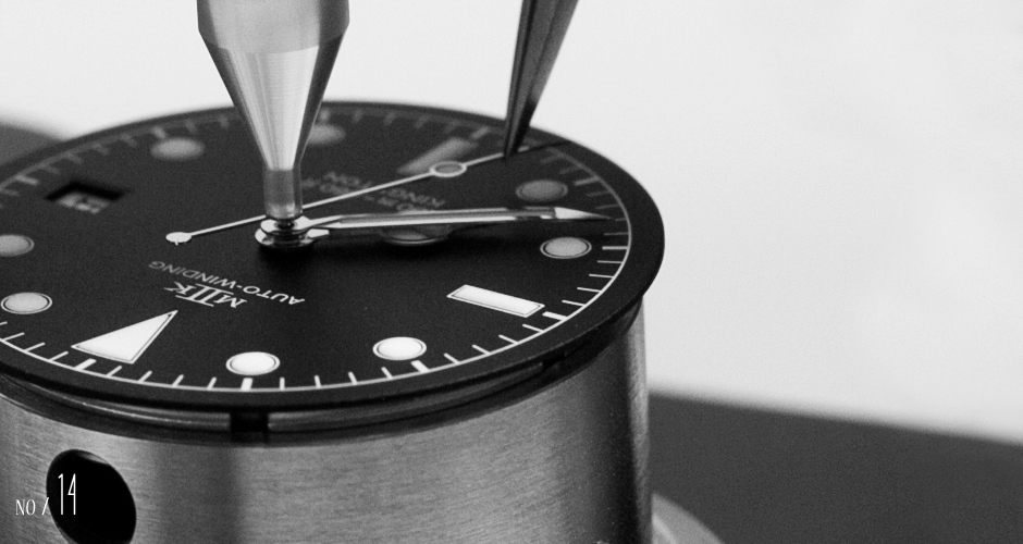 A close-up of the installation of the seconds hand.