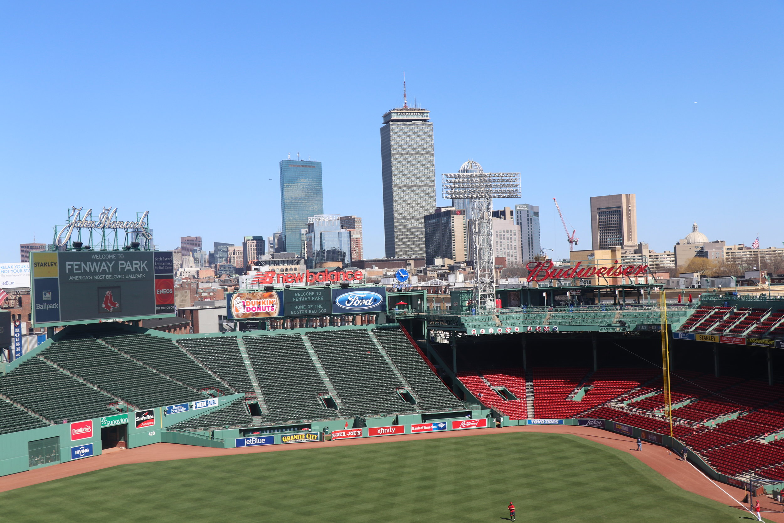 The city of Boston vie from the Green Monster - the tallest wall in all of baseball staduims - to sit up here you have to enter a raflie - could take years to get a seat