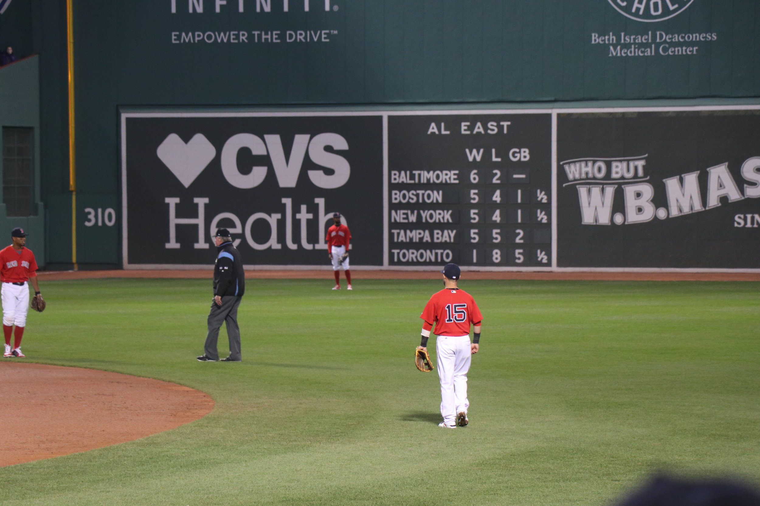 Warming up in the field before the top of the inning starts. 15 - Dustin Pedroia
