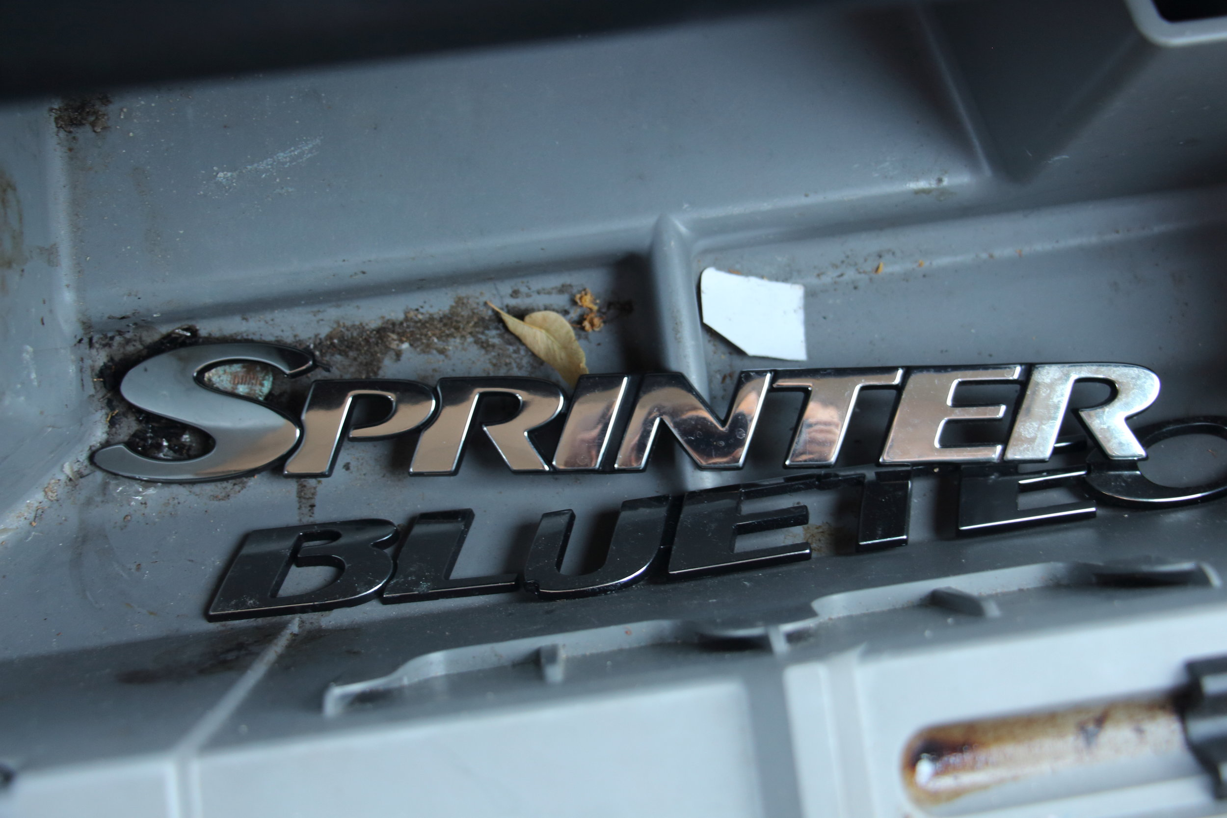 Found the Sprinter logo sadly tucked away in the glove compartment. The van's not perfect, but we loved it anyways.