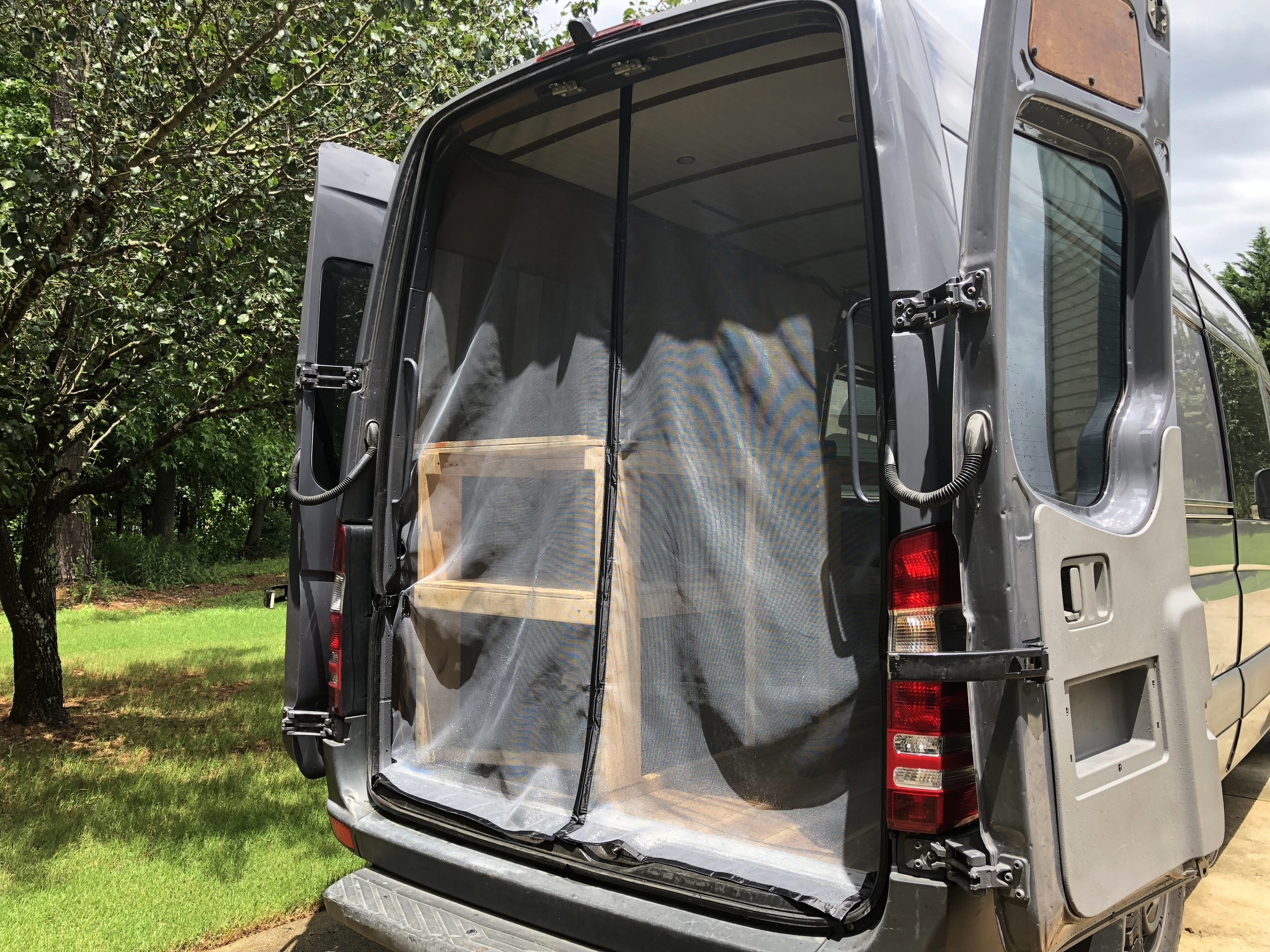 """The magnetic seam in our DIY screen lets us get in and out easily while keeping bugs out! The long """"tail"""" at the bottom sometimes prevented the screens from closing properly, so we ended up trimming it..."""