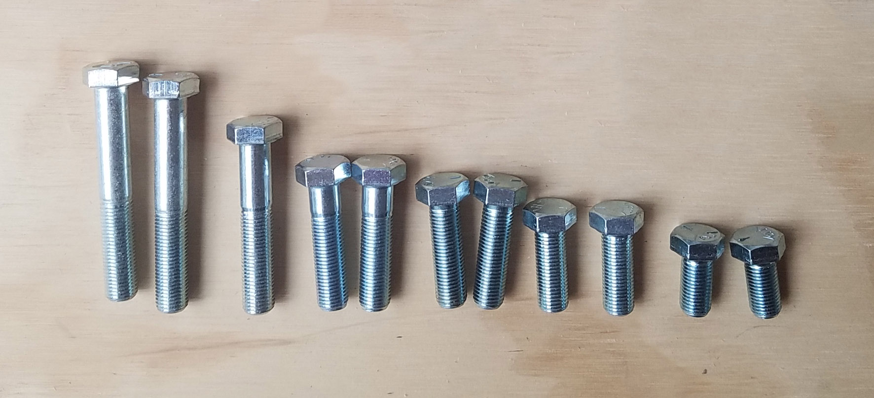 """Tip: If you're going to make a lot of custom brackets like we did, buy at least two of every length of 3/8"""" fine-threaded bolt you can find (also known as 3/8 - 24), and return what you don't use when you're done. We were surprised by how many times we needed a slightly longer or shorter bolt."""
