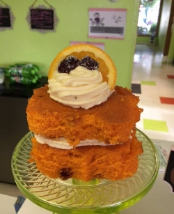 The Sweetest Treats - Have you been to Crazy Cake Cafe in Vienna yet? If not, you should! They are known for their build-your-own cakes like the one shown here, which just so happens to be the best cake we have ever tried...orange cranberry cake with orange poppy seed icing! You can choose from classic chocolate and vanilla or one of their other specialty flavors then just pick your filling and frosting and sit down to enjoy your very own personalized, single serving of cake.They are more than just cake though. You can also order special occasion cupcakes and cookies. With the holidays coming up, give them a call and let them make your dessert. Oh and they also have gift certificates,. Check out their Facebook or website for more info!