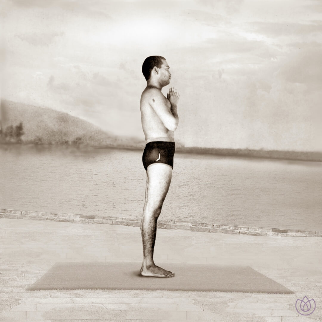 Step 1: Prayer Pose (Pranamasana) - Stand at the front edge of your mat. Keep your feet together, and make sure your weight is equally balanced on both the feet. Expand your chest and relax your shoulders.Inhale. Lift both arms up from the sides, and as you Exhale, bring your palms together in front of the chest in prayer position.