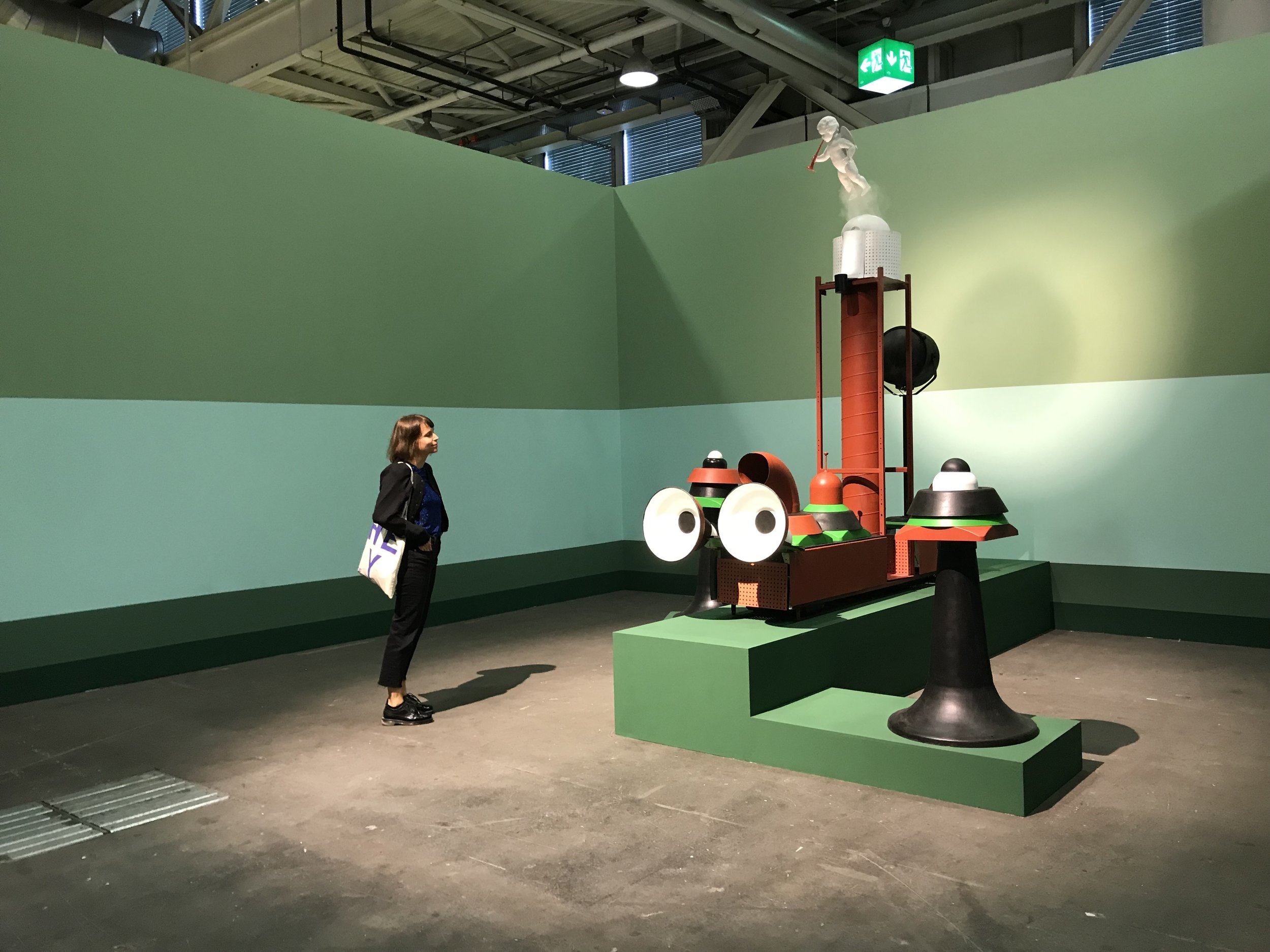 "Yvonne Robert viewing ""Steam Express and Halts"", by Kaarel Kurismaa at UNLIMITED, Art Basel 2019."