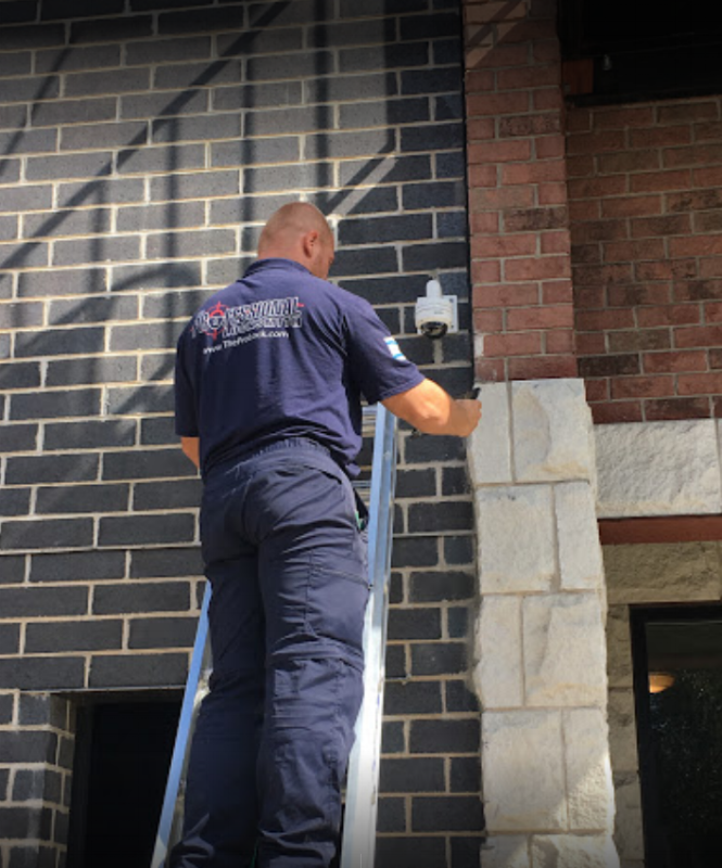 Professional Locksmith employee installing a security system