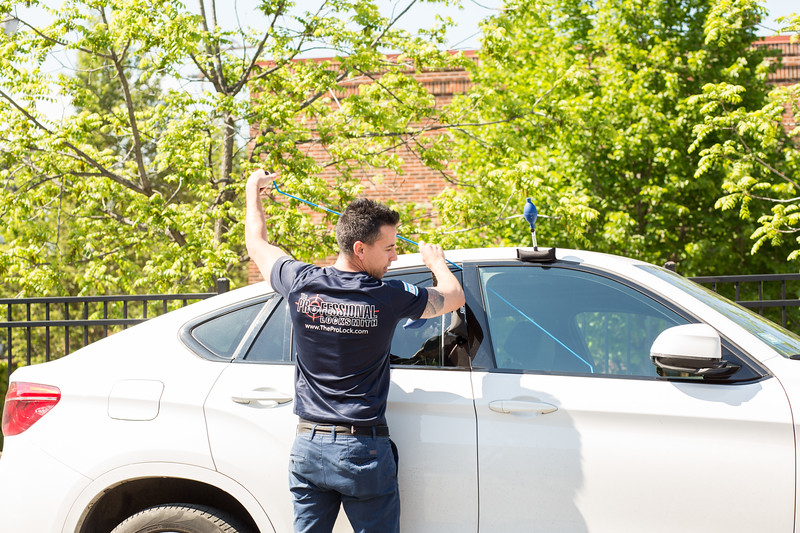 A Professional Locksmith Unlocking a Car Door