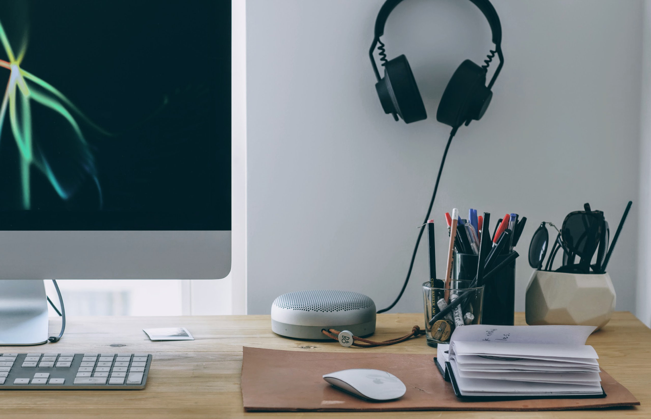 I keep the  Beoplay A1  on my desk, so I can easily switch from headphone audio to speaker audio without unplugging.