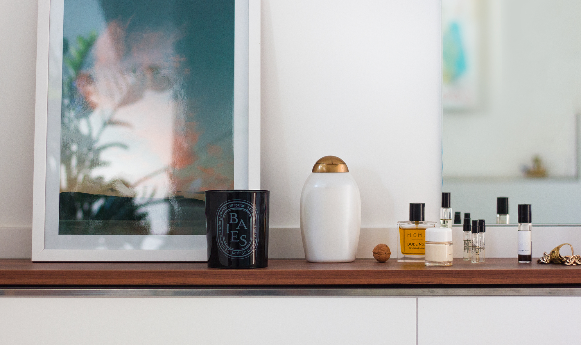 The  Diptyque Baies  candle sitting in the bathroom.