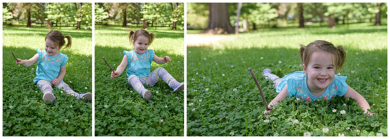 these are images of a toddler young girl sitting in the grass, playing with sticks. she is playing at piedmont park in atlanta georgia.