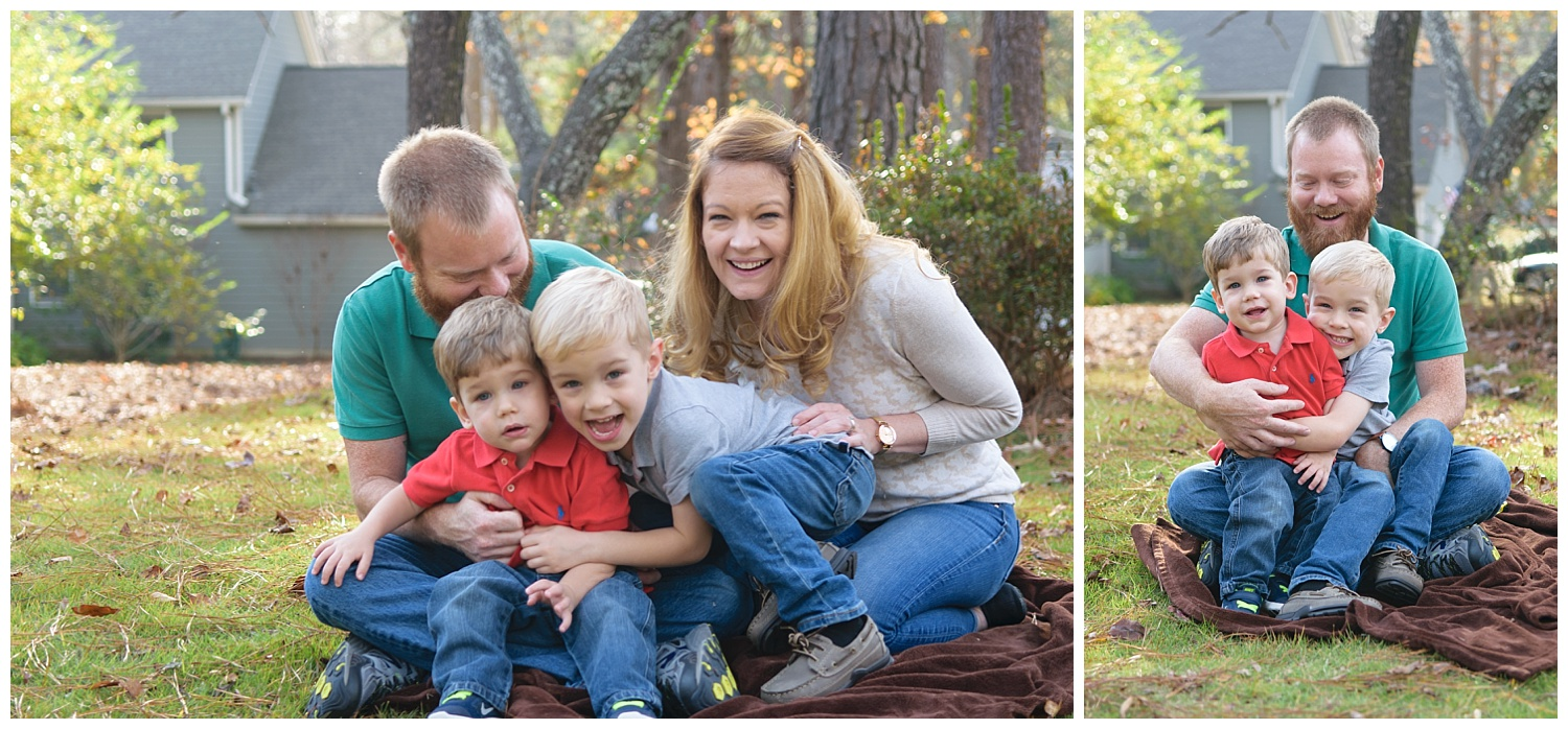 these are images of a lifestyle family session in lilburn georgia. the family is sitting on a blanket outside and hugging one another