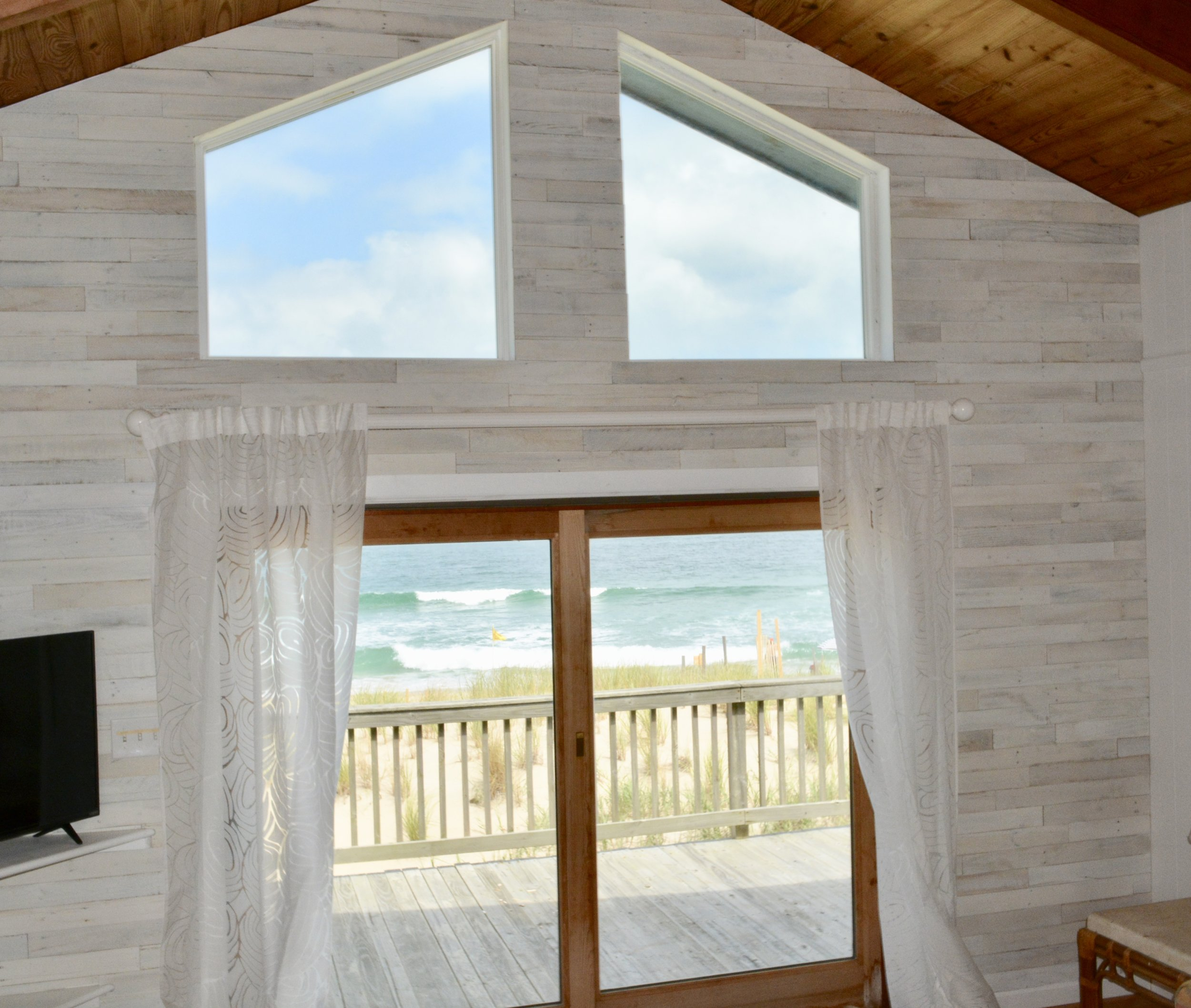"""""""I really, really love it, and so does everyone who has seen it. It makes the room feel larger and just so much more inviting. Unqualified recommendation for Reclaimed Wood Interiors!""""     Pat H - Nags Head, NC Via Survey"""