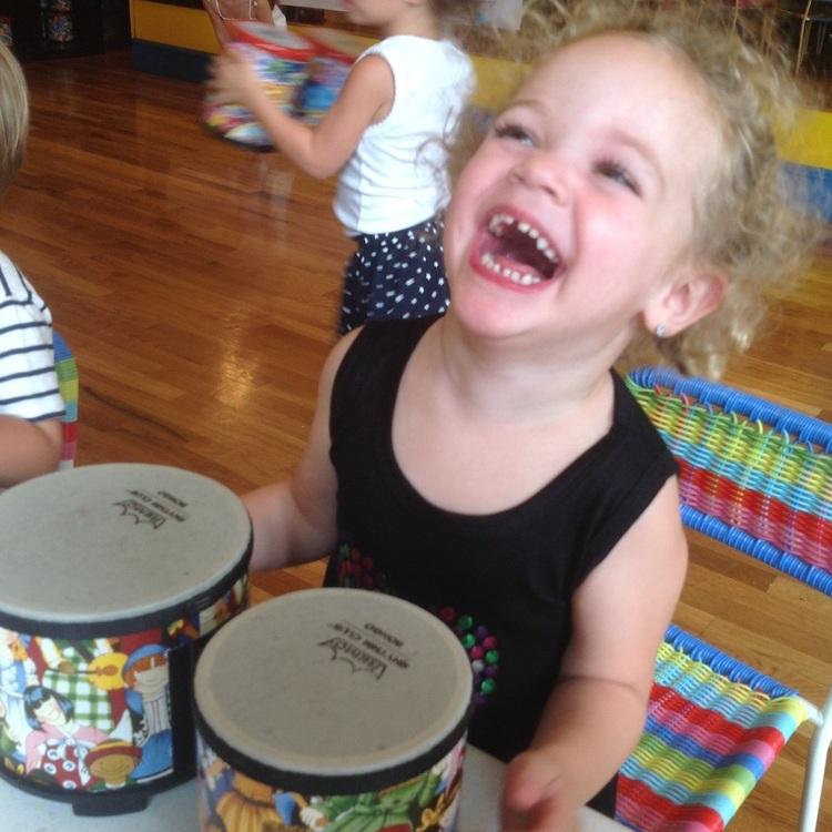 girl+laughing+with+bongos.jpg