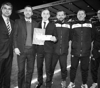 With colleagues presenting a Football League Award on match day