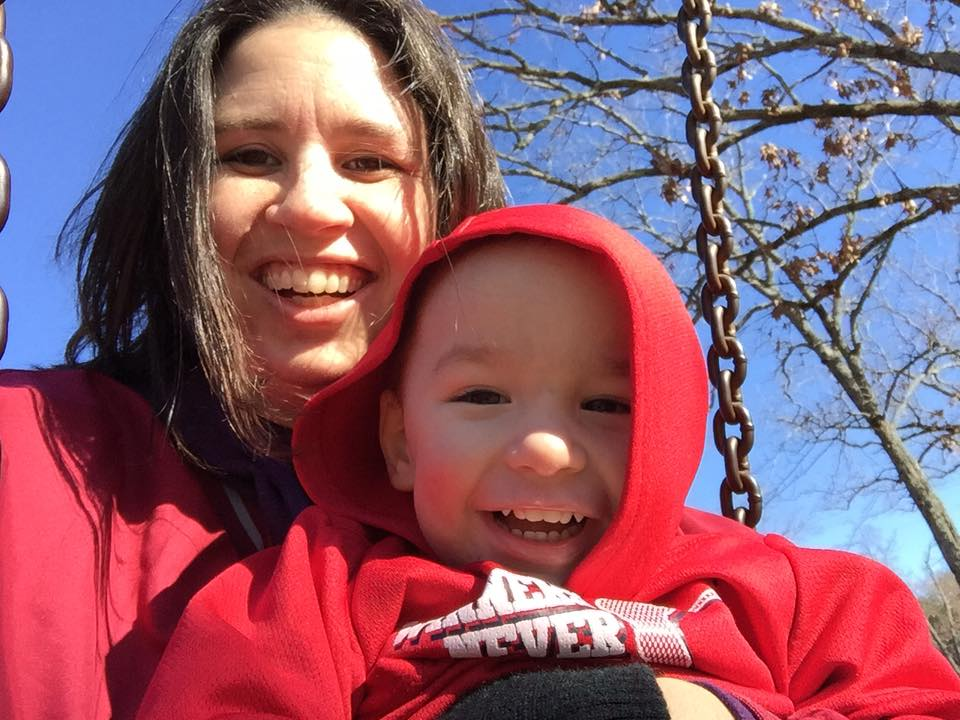 mom and son swinging on swing at oklahoma state park