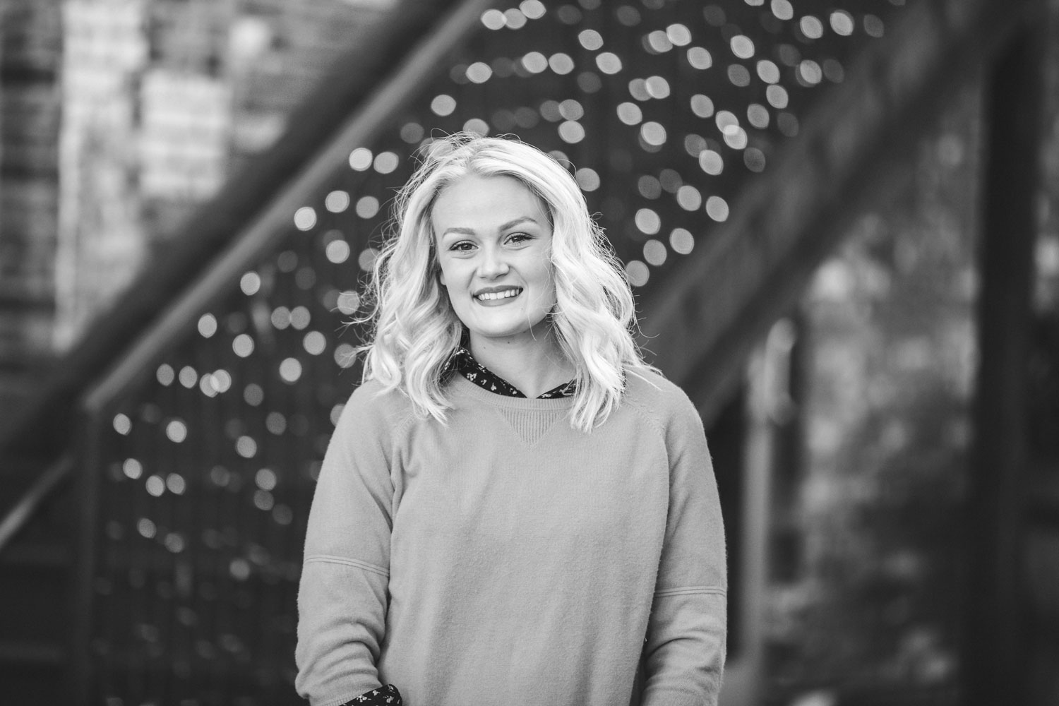 Black and White image of high school senior girl in alley in downtown Oklahoma City by Amanda Lynn.