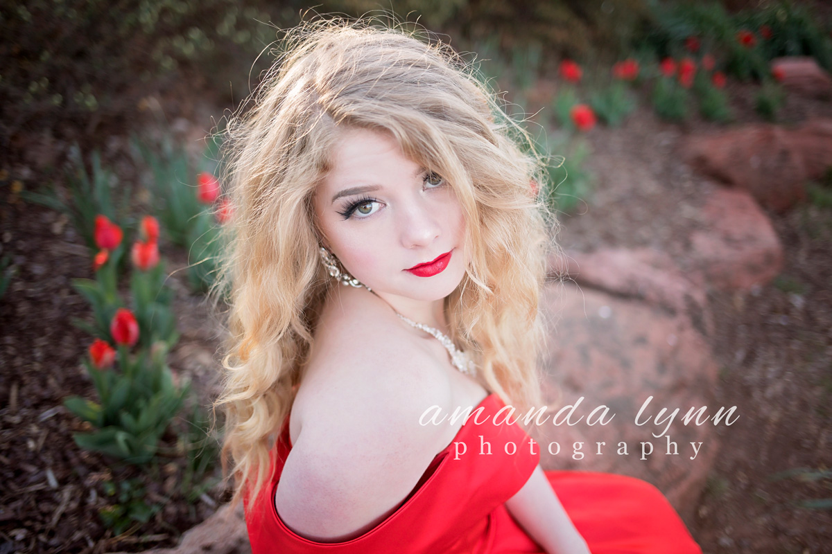 Close up images of senior girl with long, blonde hair, wearing red prom dress, looking at camera at Will Rogers Park in Oklahoma City, Oklahoma.