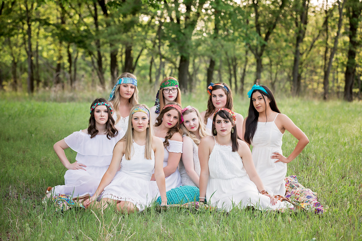 Group image of 2019 senior models wearing all white dresses and head wraps at Martin Nature Park in Oklahoma City by Amanda Lynn.