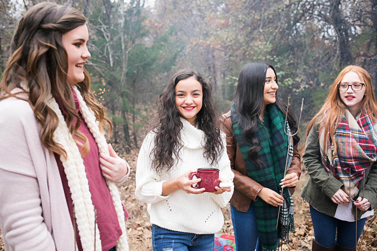 Senior girls standing around a camp fire in Oklahoma by Amanda Lynn.