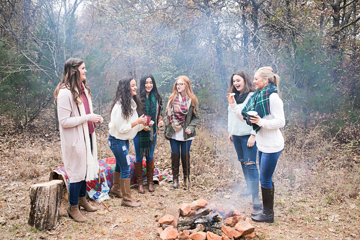 Oklahoma high school senior girls standing around a camp fire in Oklahoma, group shoot by Amanda Lynn Photography.
