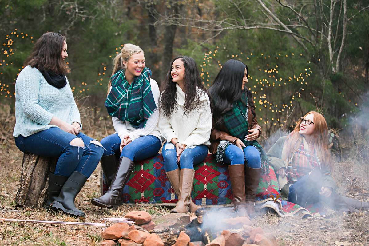 Oklahoma high school seniors sitting around a camp fire in for group photo shoot by Amanda Lynn Photography.