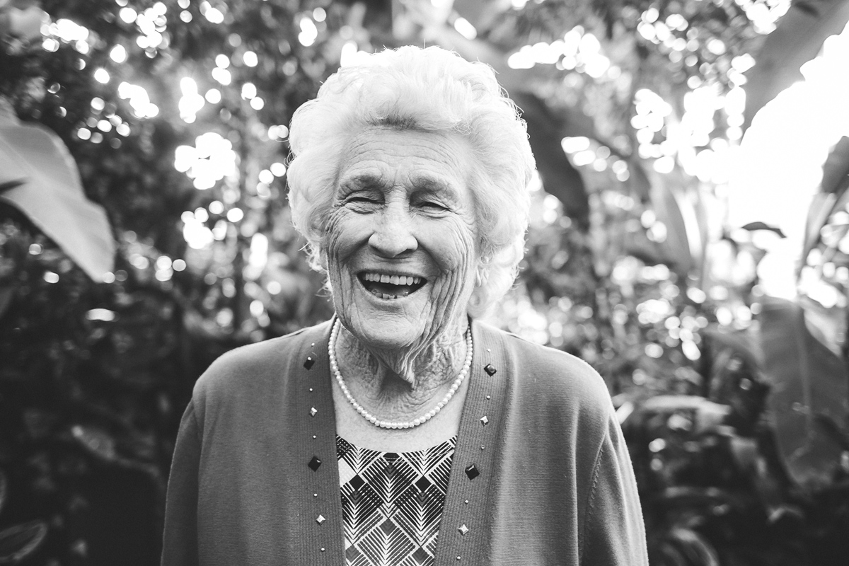 Black and white image of older lady laughing at the Crystal Bridge in Oklahoma City, by Amanda Lynn.