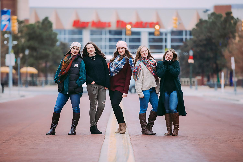Amanda Lynn's Elite Senior Model team standing on brick road in brick town. Christmas photoshoot by Amanda Lynn Photography in Oklahoma City, Oklahoma.